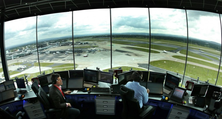 Air traffic controllers Pete Robinson (L) and Steve Bowden test systems in the new control tower at Manchester Airport, northern England. The 16 million pound Sterling (24.7 million US dollars), 60 metre (197 feet) tall tower goes live on June 27. (Phil Noble/Reuters)