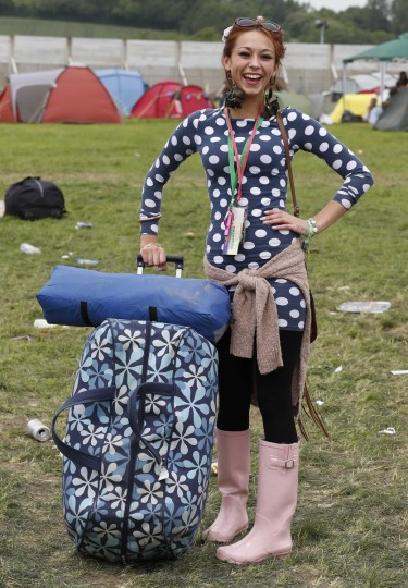 Natalie Marden, 20, arrives on the second day of Glastonbury music festival at Worthy Farm in Somerset, June 27, 2013. (Olivia Harris/Reuters)