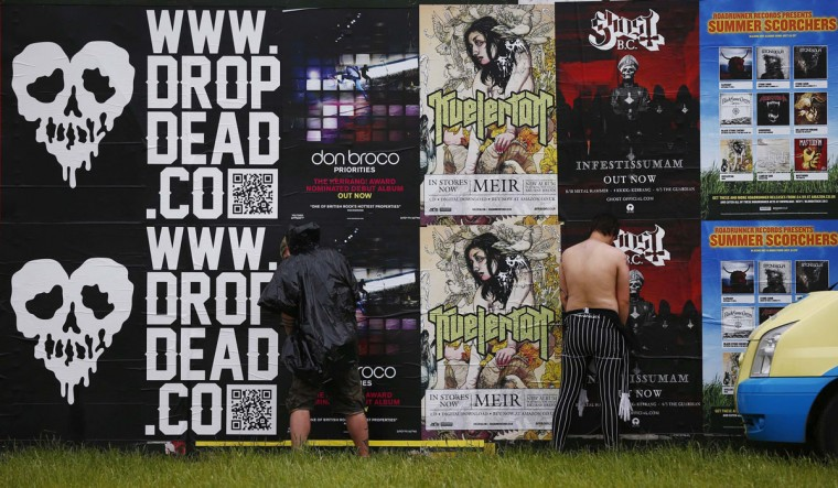 Men urinate against a wall during the Download music festival in Castle Donington, central England. (Darren Staples/Reuters)