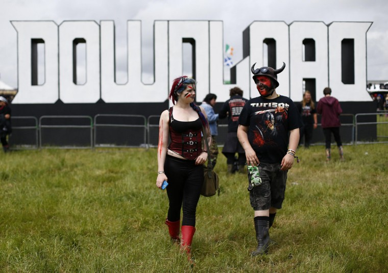 Fans walk to the main stage during the Download music festival in Castle Donington, central England. (Darren Staples/Reuters)
