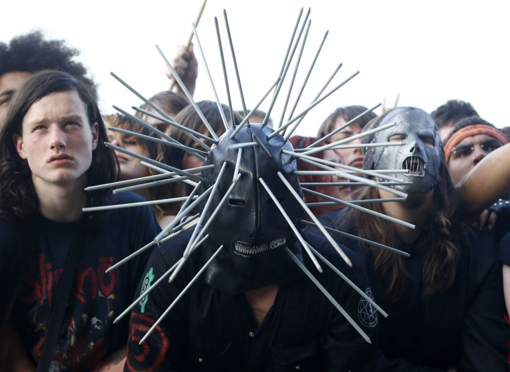 Men watch Korn perform during the Download music festival in Castle Donington, central England. (Darren Staples/Reuters)