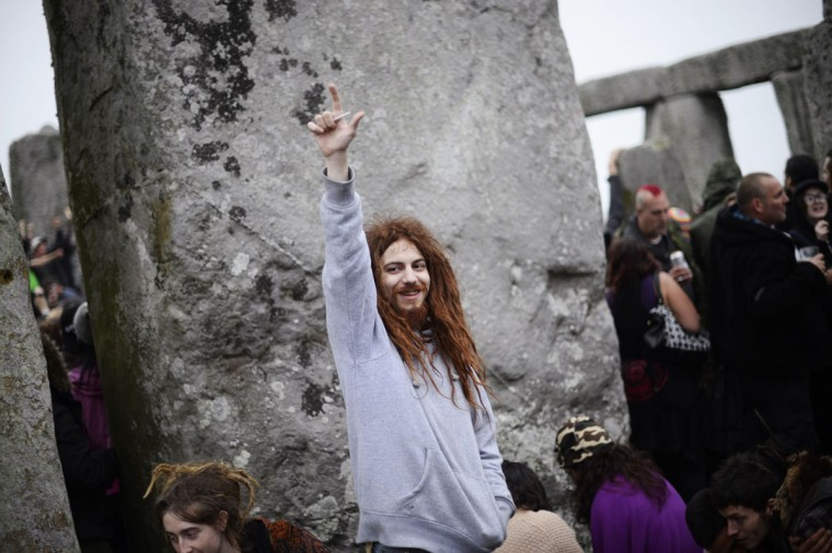 A reveler gestures as he celebrates the summer solstice at the ancient Stonehenge monument in southern England. (Dylan Martinez/Reuters)