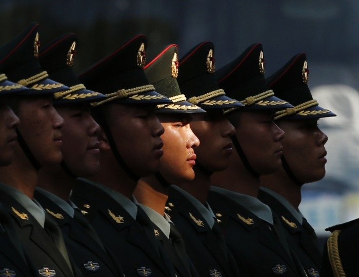 Members of an honor guard stand in line as they prepare for a welcoming ceremony for visiting Vietnamese President Truong Tan Sang outside the Great Hall of the People in Beijing. (Kim Kyung-Hoon /Reuters photo)