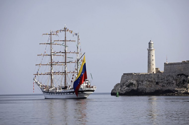 The Simon Bolivar training ship, from the Venezuelan navy's flagship, leaves Havana's port next to the lighthouse of colonial-era fortress 'El Morro Cabana.' (Desmond Boylan/Reuters)