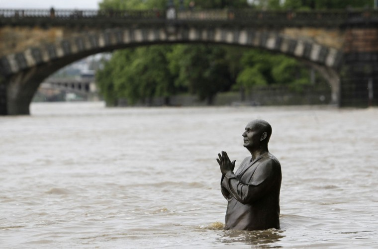 The statue of world harmony leader Sri Chinmoy is partially submerged in water from the rising Vltava river in Prague June 2, 2013. Rivers across the Czech Republic are rising fast due to heavy rain. (David W Cerny/Reuters)