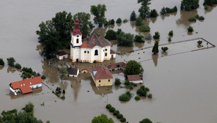 An aerial view shows the submerged church of the village of Pocaply near the town of Litomerice, June 4, 2013. The worst floods to hit the Czech Republic in a decade forced the evacuation of almost 2,700 people from low-lying areas while the rising water threatened Prague's historic centre, forced school closures and disrupted public transport. (Petr Josek/Reuters)