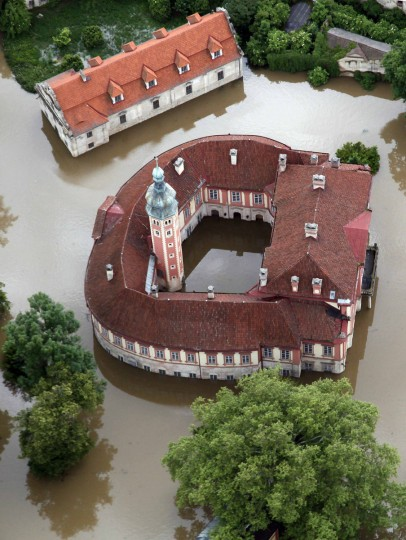 An aerial view shows the submerged castle of Libechov near the town of Melnik, June 4, 2013. The worst floods to hit the Czech Republic in a decade forced the evacuation of almost 2,700 people from low-lying areas while the rising water threatened Prague's historic centre, forced school closures and disrupted public transport. (Petr Josek/Reuters)