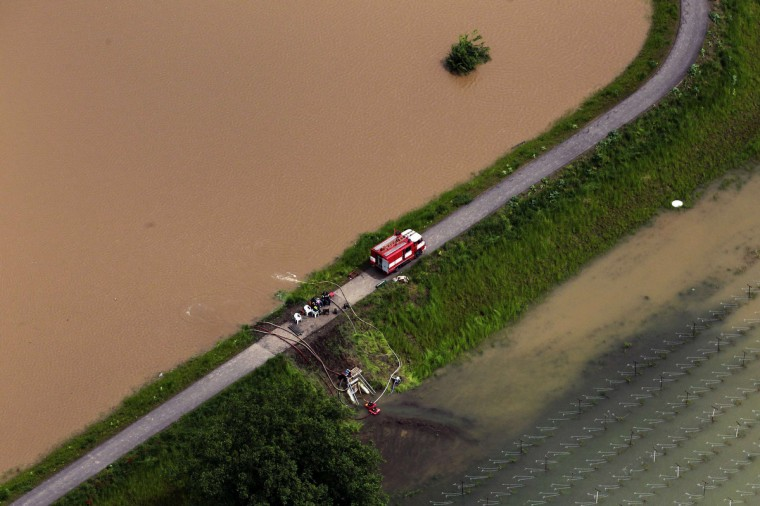 Firemen pump water out from a submerged field near the city of Melnik, June 4, 2013. The worst floods to hit the Czech Republic in a decade forced the evacuation of almost 2,700 people from low-lying areas while the rising water threatened Prague's historic centre, forced school closures and disrupted public transport. (Petr Josek/Reuters)