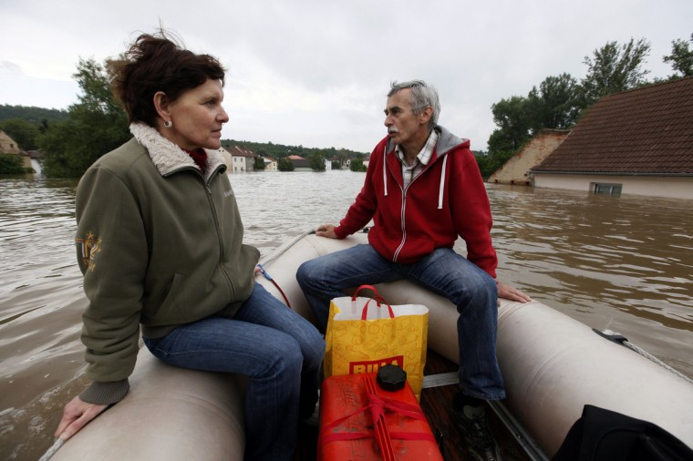 Residents observe their flooded village of Kresice near the city of Litomerice, June 4, 2013. (Petr Josek/Reuters)