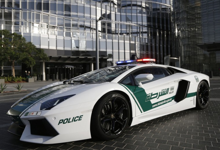 A Lamborghini Aventador police car is seen near the Burj Khalifa in Dubai. The Dubai Police fleet of cars includes Aston Martin, Bentley Continental GT Coupe, Ferrari, and a recently added Bugatti Veyron. (Jumana El Heloueh/Reuters)