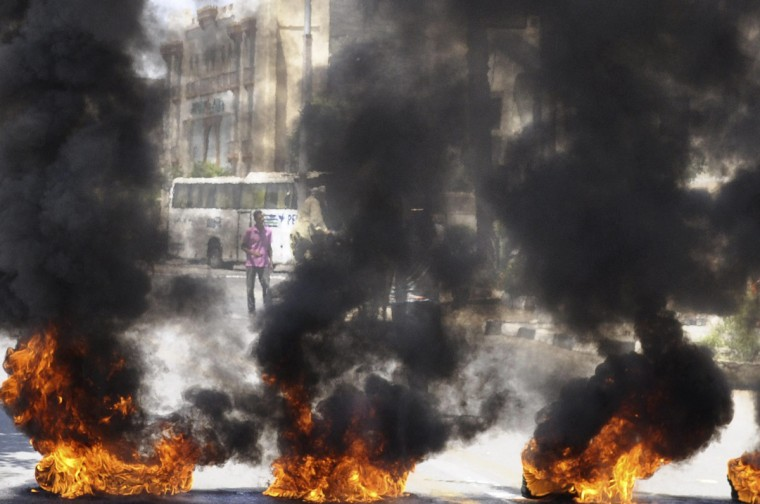 Protesters burn tires in front of the Luxor governorate building to protest against the newly-appointed governor, Adel Mohamed al-Khayat, who was a member of the militant group, al-Gamaa al-Islamiya, in Luxor. (stringer/Reuters photo)