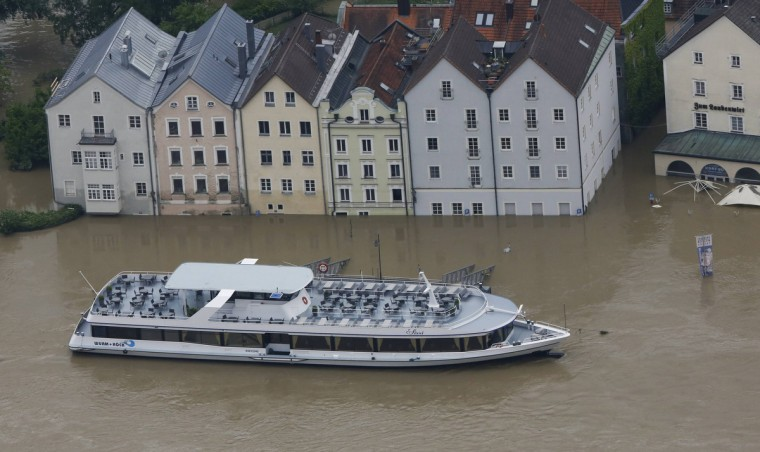 """The tourist boat """"Sissi"""" is seen on the flooded river Danube in the three-rivers city of Passau in south-eastern Bavaria June 4, 2013. Torrential rain in the south and south-east of Germany caused heavy flooding over the weekend, forcing people to evacuate their homes. (Wolfgang Rattay/Reuters)"""
