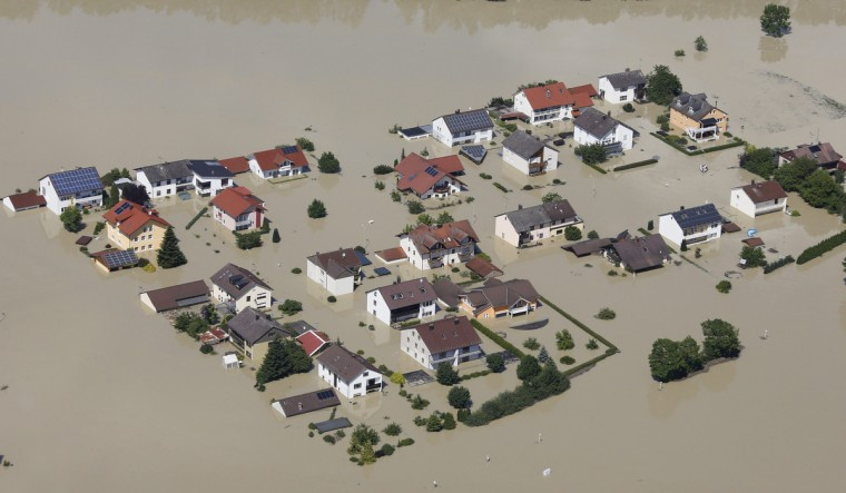 A small settlement along the A3 motorway is flooded near the eastern Bavarian city of Deggendorf June 5, 2013, after one of Europe's most frequented highways was flooded by the nearby river Danube on June 4. Chancellor Angela Merkel promised 100 million euros to victims of Germany's worst flood in a decade on Tuesday as she toured areas devastated by the deluge, which has killed 12 people across central Europe. (Wolfgang Rattay/Reuters)
