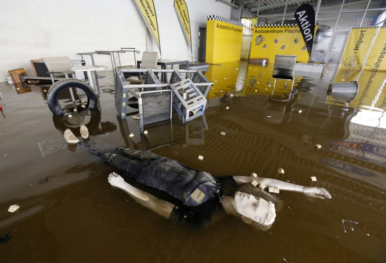 A display dummy floats in a flooded car dealership in Fischerdorf, a suburb of the eastern Bavarian city of Deggendorf, after the floods of the nearby Danube river subsided. Floods have forced tens of thousands of people to flee their homes over the past week in Germany, Austria, Slovakia, Poland, the Czech Republic and Hungary. At least a dozen people have died because of the deluge. (Wolfgang Rattay/Reuters)