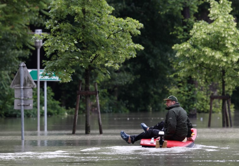 A man in a boat floats along a submerged street in the flood water of the swollen Danube river in Klosterneuburg, the neighbouring city north of Vienna, June 4, 2013. Torrential rain in Tyrol, Salzburg, Upper and Lower Austria caused heavy flooding over the weekend, forcing people to evacuate their homes. (Heinz-Peter Bade/Reuters)