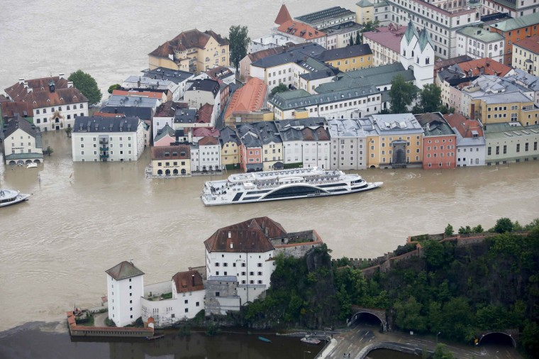 """The tourist boat """"Donau"""" (Danube) is seen on the flooded river Danube in the three-rivers city of Passau in south-eastern Bavaria June 4, 2013. Torrential rain in the south and south-east of Germany caused heavy flooding over the weekend, forcing people to evacuate their homes. (Wolfgang Rattay/Reuters)"""