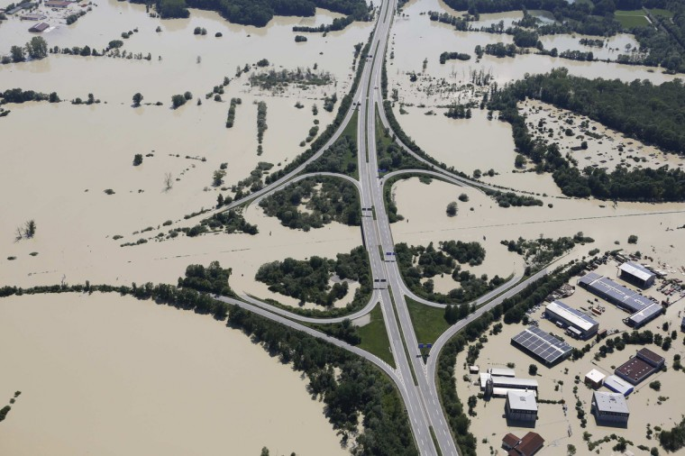 The highway crossing of the A92 (L) and the A3 (top) is flooded near the eastern Bavarian city of Deggendorf June 5, 2013, after one of Europe's most frequented highways was flooded by the nearby river Danube on June 4. Chancellor Angela Merkel promised 100 million euros to victims of Germany's worst flood in a decade on Tuesday as she toured areas devastated by the deluge, which has killed 12 people across central Europe. (Wolfgang Rattay/Reuters)