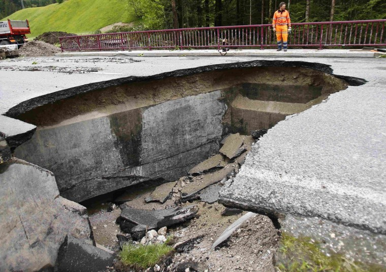 A damaged street is pictured in the western Austrian village of Erpfendorf June 4, 2013. Torrential rain caused widespread flooding and landslides across Austria on Sunday, forcing hundreds of people to evacuate their homes. (Dominic Ebenbichler/Reuters)