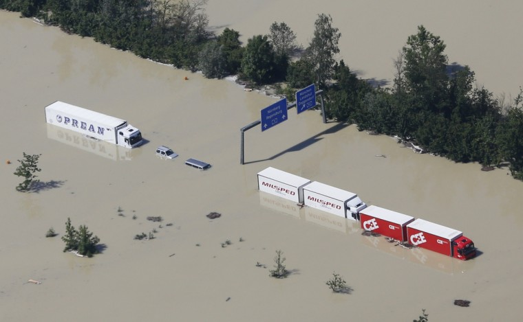 Trucks stand stranded on the flooded motorway A3 near the eastern Bavarian city of Deggendorf June 5, 2013, after one of Europe's most frequented highways was flooded by the nearby river Danube on June 4. Chancellor Angela Merkel promised 100 million euros to victims of Germany's worst flood in a decade on Tuesday as she toured areas devastated by the deluge, which has killed 12 people across central Europe. (Wolfgang Rattay/Reuters)