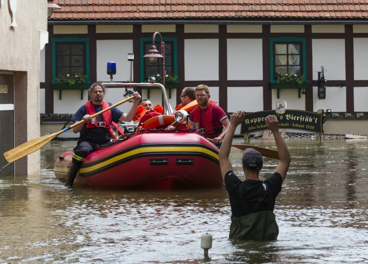 Rescue workers ride a boat in the flooded streets of the east German town of Bad Schandau after the Elbe river has broken its banks, June 5, 2013. (Thomas Peter/Reuters)