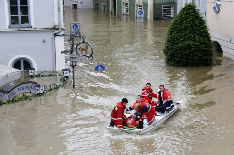 A rescue team on a dinghy evacuates a man from the flooded district of the Bavarian town of Passau, about 200 km (124 miles) north-east of Munich June 4, 2013. Torrential rain in the south and south-east of Germany caused heavy flooding over the weekend, forcing people to evacuate their homes. (Wolfgang Rattay/Reuters)