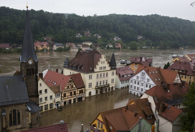 A general view shows the flooded market square of the town of Wehlen in the federal state of Saxony after the Elbe river broke its banks, June 4, 2013. Torrential rain in the south and south-east of Germany caused heavy flooding over the weekend forcing people to evacuate their homes. (Thomas Peter/Reuters)
