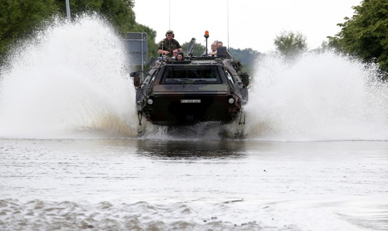 German armed forces Bundeswehr soldiers evacuate residents from the village of Schoenhausen, flooded by the river Elbe, with an armed personel carrier Fuchs to Hohengoehren, north of Magdeburg. Tens of thousands of people have been forced to leave their homes and there have been at least a dozen deaths as a result of floods that have hit Germany, Austria, Slovakia, Poland and the Czech Republic over the past week. (Fabrizio Bensch/Reuters)