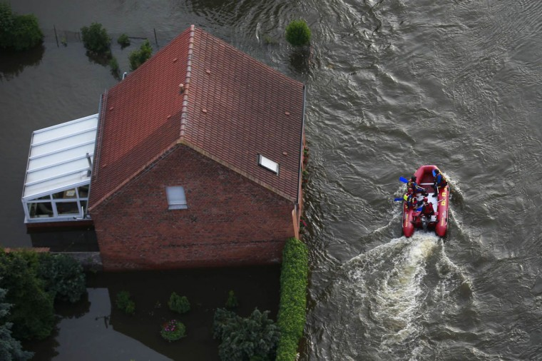 A boat of the German Life Saving Association (DLRG) evacuates people from the village of Fischbeck, in the federal state of Saxony Anhalt, after it was flood by the Elbe river. Tens of thousands of Germans, Hungarians and Czechs were evacuated from their homes on Wednesday as soldiers raced to pile up sandbags to hold back rising waters in the region's worst floods in a decade. (Thomas Peter /Reuters photo)