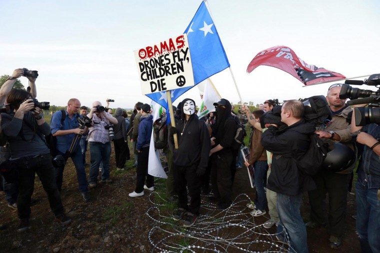 Anti-G8 protestors break through the security fence surrounding the G8 Summit in the Lough Erne Golf Resort in County Fermanagh June 17, 2013. (Cathal McNaughton/Reuters)