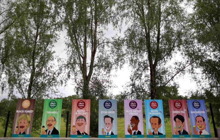 Placards depicting different flavoured ice cream for the G8 leaders are seen attached to a fence at a service station on the road to the Lough Erne Golf Resort, where the G8 Summit is being held, near Enniskilen in Northern Ireland June 18, 2013. (Cathal McNaughton/Reuters)