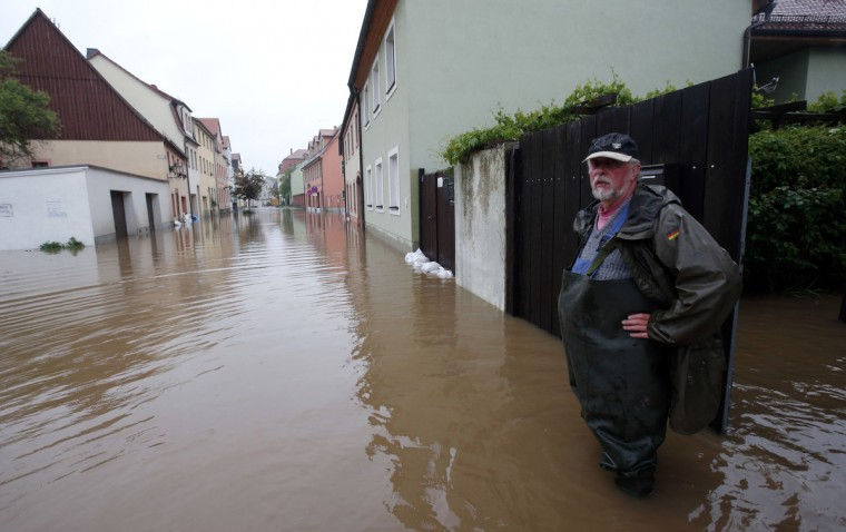 A resident stands at his property on a flooded street in the town of Grimma, near Leipzig June 2, 2013. Authorities in the German state of Saxon have declared Grimma a disaster area, according to local media. (Fabrizio Bensch/Reuters)