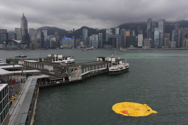 A deflated Rubber Duck by Dutch conceptual artist Florentijn Hofman floats on Hong Kong's Victoria Harbour May 15, 2013. The 16.5-meter-high (54 ft) inflatable sculpture, which made its first public appearance in the territory on May 2, will be shown at the Ocean Terminal for a month. The Rubber Duck was deflated after some of its parts broke. (Tyrone Siu/Reuters)