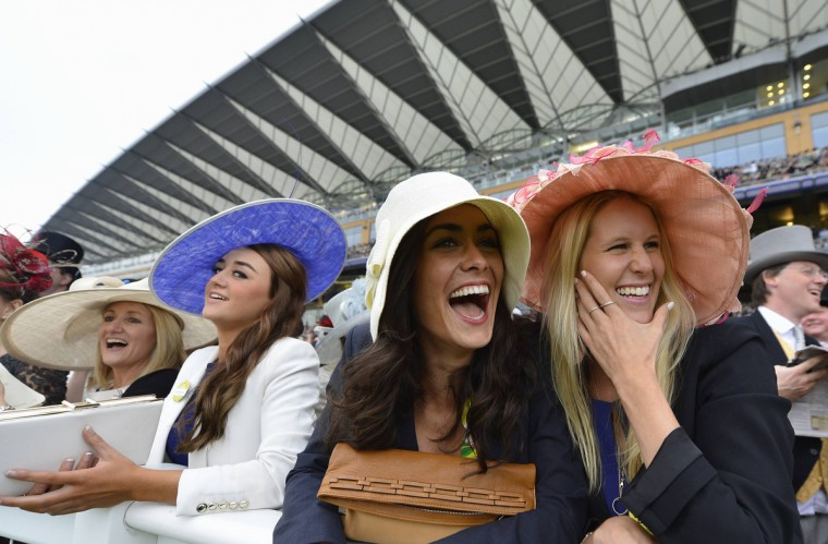 Racegoers view horses in the parade ring during the first day of the Royal Ascot horse racing festival at Ascot, southern England. (Toby Melville/Reuters photo)