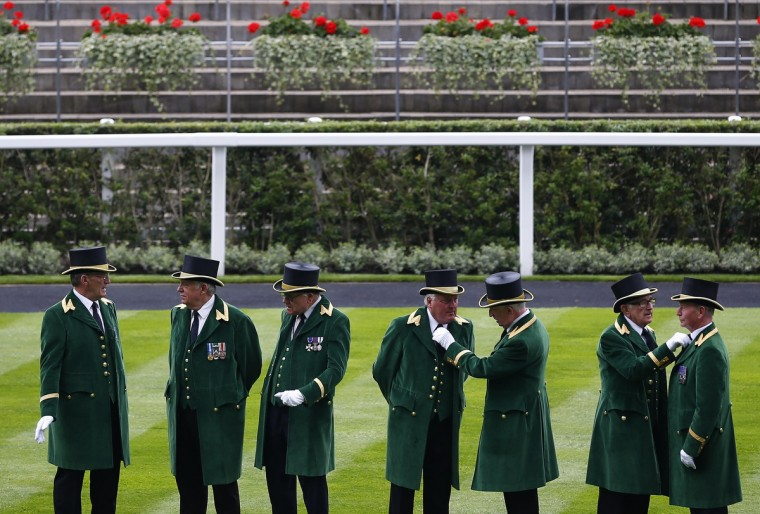 Greencoats who attend to Britain's Queen Elizabeth prepare for the second day of the Royal Ascot horse racing festival at Ascot, southern England. (Darren Staples/Reuters photo)