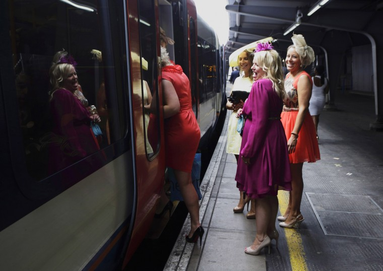 Women board a train at Waterloo Station in London, bound for Ladies' Day at the Royal Ascot horse racing festival. (Kevin Coombs/Reuters photo)