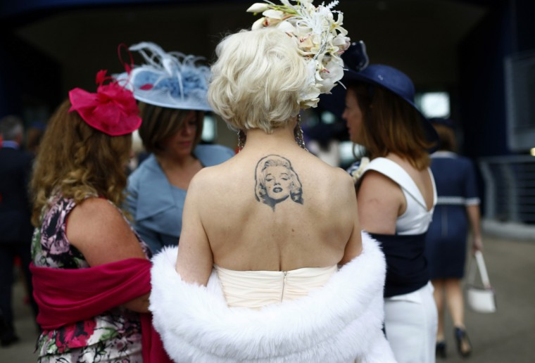 A racegoer displays a tattoo of actress Marilyn Monroe during Ladies' Day at the Royal Ascot horse racing festival at Ascot, southern England. (Darren Staples/Reuters photo)