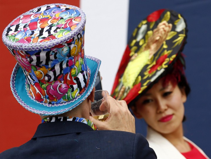 A man takes a picture of a friend during the first day of the Royal Ascot horse racing festival at Ascot, southern England. (Darren Staples/Reuters photo)