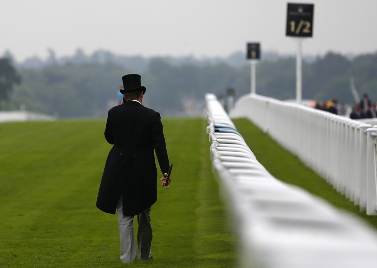 A man walks the course before the start of racing on the second day of the Royal Ascot horse racing festival at Ascot, southern England. (Darren Staples/Reuters photo)