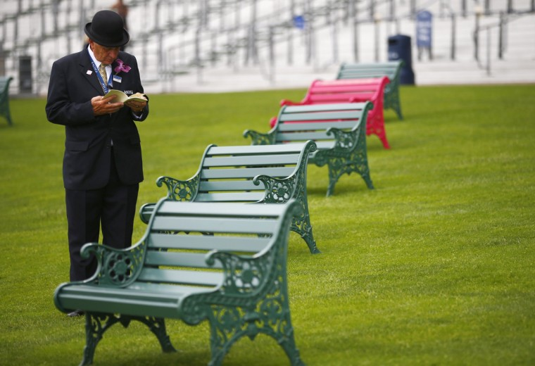 A steward studies the race card on the second day of the Royal Ascot horse racing festival at Ascot, southern England. (Darren Staples/Reuters photo)