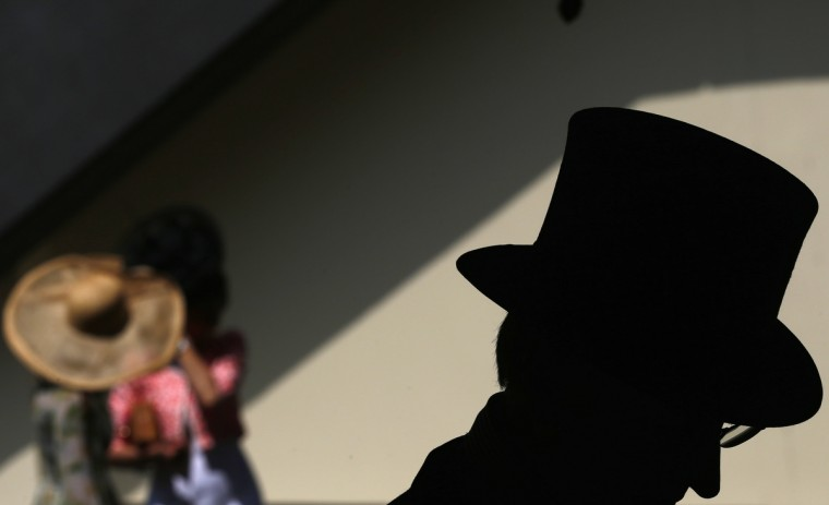 A man wearing a top hat attends the second day of the Royal Ascot horse racing festival at Ascot, southern England. (Darren Staples/Reuters photo)