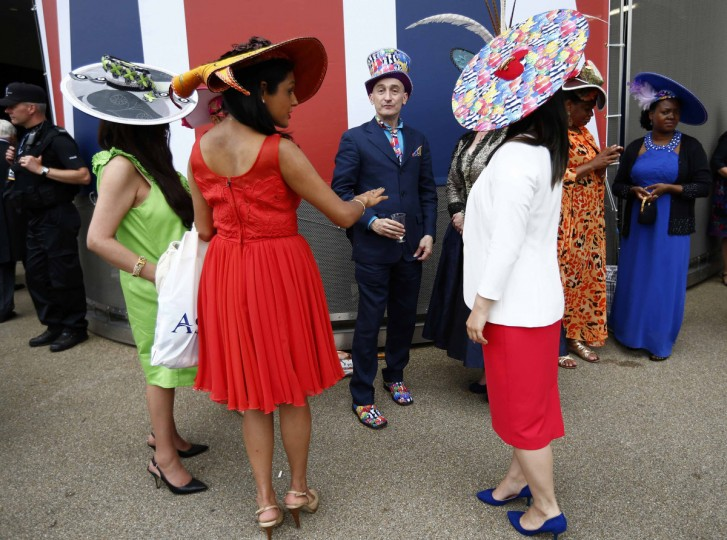 Race goers attend the first day of the Royal Ascot horse racing festival at Ascot, southern England. (Darren Staples/Reuters photo)