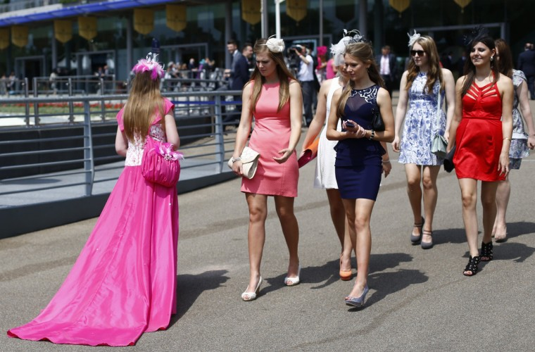 Women look at the dress of a race goer on the second day of the Royal Ascot horse racing festival at Ascot, southern England. (Darren Staples/Reuters photo)