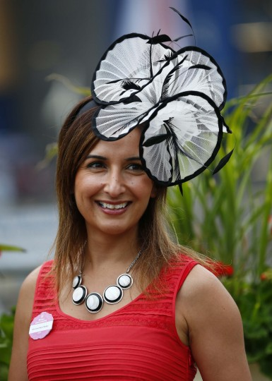 A race goer arrives for Ladies' Day at the Royal Ascot horse racing festival at Ascot, southern England. (Darren Staples/Reuters photo)