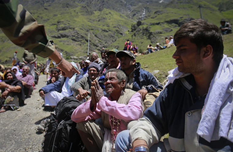 A survivor pleads with a soldier to allow him to board an army helicopter, during rescue operations at Badrinath in the Himalayan state of Uttarakhand, India. Early monsoon rains have swollen the Ganges, India's longest river, swept away houses, killed at least 138 people and left tens of thousands stranded, local newspapers reported. (Danish Siddiqui/Reuters)