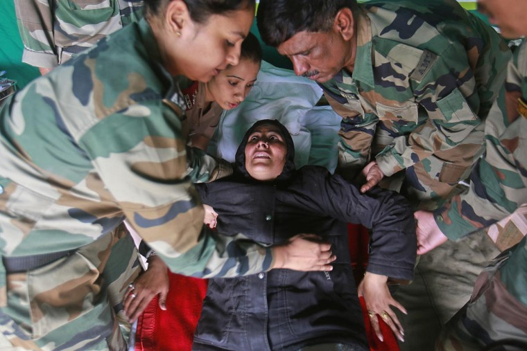 A woman cries in pain she is carried by soldiers from an army helicopter during a rescue operation at Joshimath in the Himalayan state of Uttarakhand June 24, 2013. Flash floods and landslides unleashed by early monsoon rains have killed at least 560 people in Uttarakhand and left tens of thousands missing, officials said on Saturday, with the death toll expected to rise significantly. (Danish Siddiqui/Reuters)