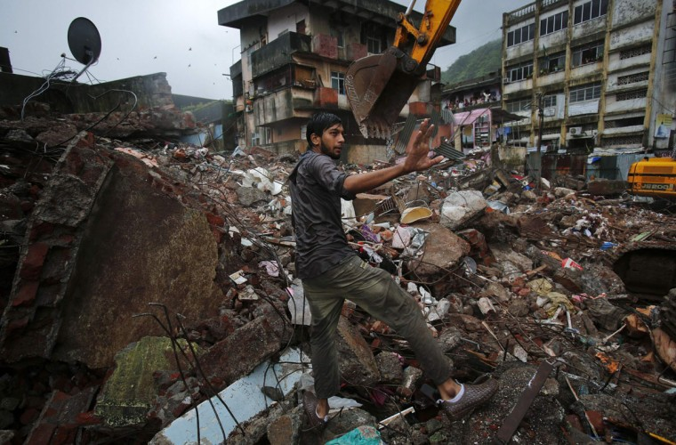 A resident gestures while searching for his belongings amid the debris of a collapsed residential building in Mumbra, in Thane district, on the outskirts of Mumbai, India. At least nine people were killed and 14 injured when the building collapsed in the early hours on Friday, local media reported. (Vivek Prakash/Reuters)