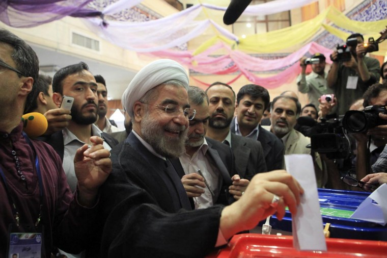 Presidential candidate Hassan Rohani casts his ballot during the Iranian presidential election in Tehran June 14, 2013. (Yalda Moayeri/Reuters)