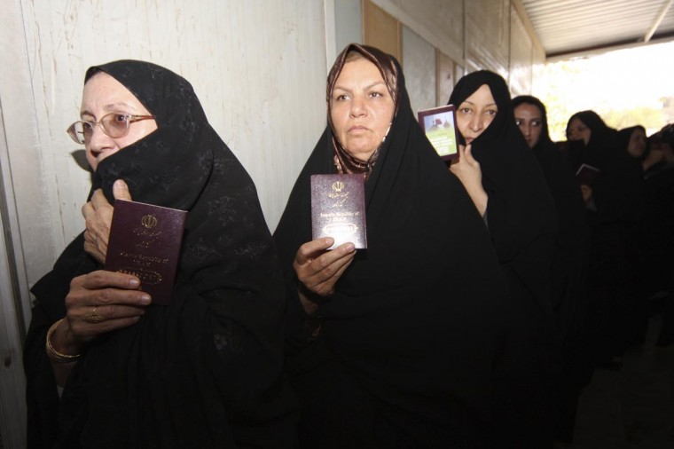 Iranian women stand in line with their passports as they wait to vote for the Iranian presidential election at the Iranian Consulate in Kerbala, 110 km (70 miles) south of Baghdad, June 14, 2013.(Mushtaq Muhammed/Reuters)