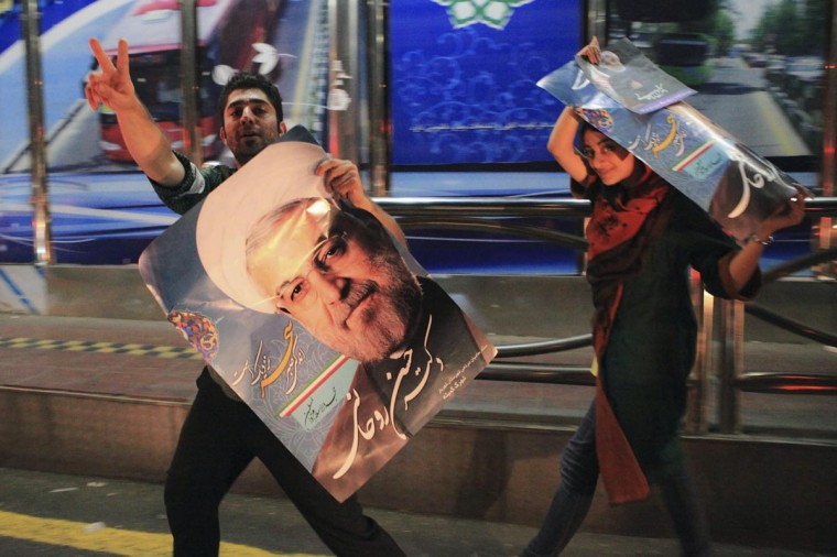 Supporters of moderate cleric Hassan Rohani celebrate his victory in Iran's presidential election along a street in Tehran June 16, 2013. (Yalda Moayeri/Reuters)
