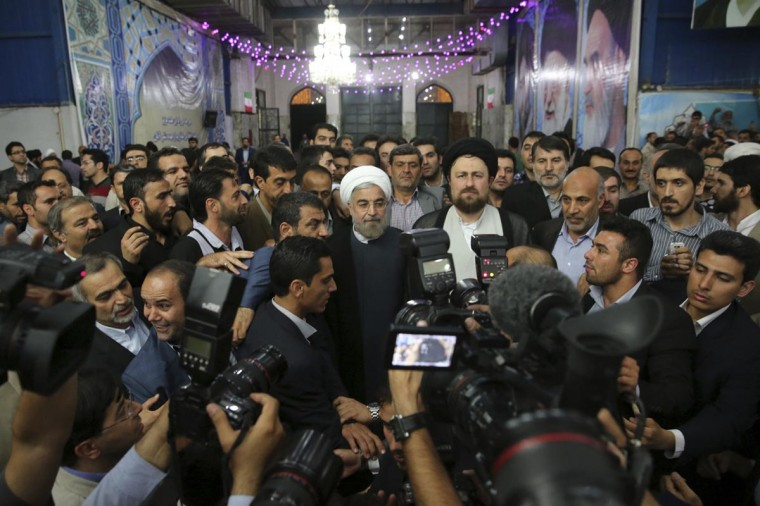 Iranian President-elect Hassan Rohani (C) speaks to the media following a visit to the Khomeini mausoleum in Tehran June 16, 2013. (Seyed Hassan Mousavi/Fars News via Reuters)
